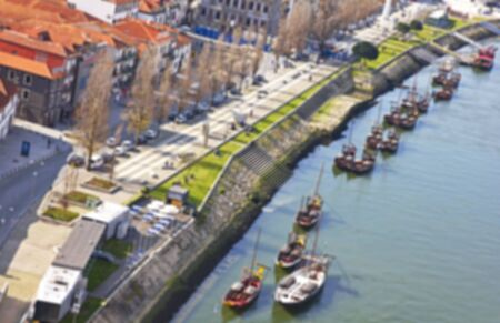 ribeira: Portugal. Vila Nova de Gaia opposite Porto city. View of Douro river embankment in the morning. In blur style
