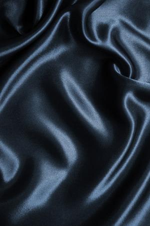 エレガントな滑らかなダークグレー シルクやサテンの背景として使用することができます。 写真素材