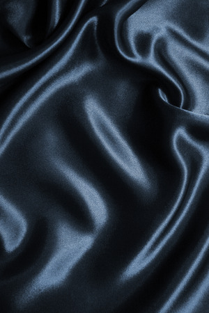 Smooth elegant dark grey silk or satin can use as background