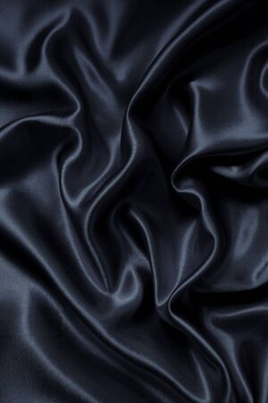 sensuous: Smooth elegant dark grey silk or satin can use as background