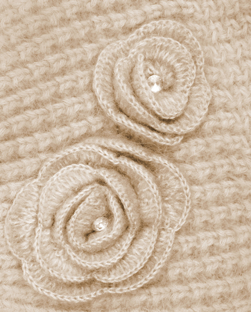 counterpane: Brown wool flowers on brown wool knitted can use as background Stock Photo
