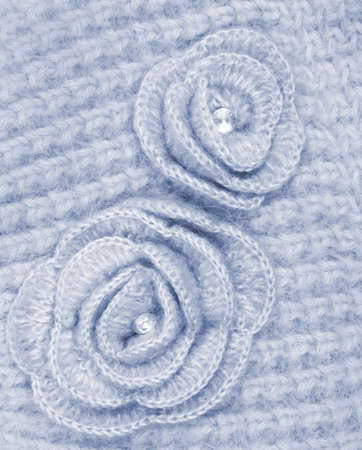 counterpane: Grey wool flowers on grey wool knitted can use as background