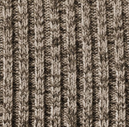 counterpane: Beige knitted wool texture can use as background