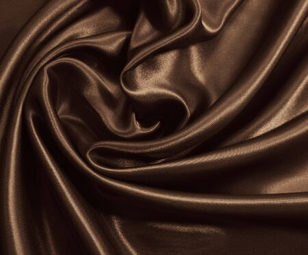 Smooth elegant brown silk or satin can use as background. In Sepia toned. Retro style