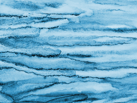 Abstract watercolor background with blue layers on paper texture