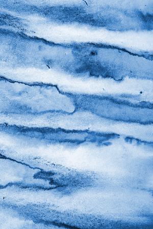 Abstract blue watercolor on paper texture can use as background. Christmas background or New Year background design