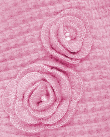 counterpane: Pink wool flowers on pink wool knitted can use as background Stock Photo