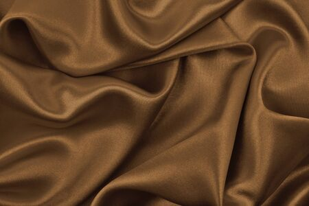 Smooth elegant brown silk or satin texture can use as abstract background. Luxurious background design wallpaper. In Sepia toned. Retro style