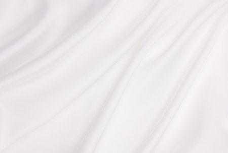 silvery: Smooth elegant white silk or satin luxury cloth texture can use as wedding background. Luxurious background design