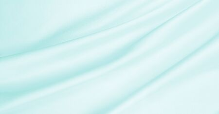 silvery: Smooth elegant blue silk or satin luxury cloth texture can use as abstract background. Luxurious background design