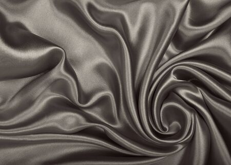 Smooth elegant brown silk or satin can use as wedding background. In Sepia toned. Retro style Stock Photo