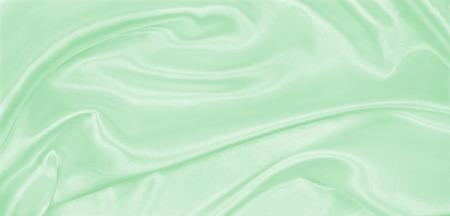 Seda elegante verde de seda o satinado de textura de tela de lujo puede utilizar como fondo abstracto. Diseño de fondo lujoso Foto de archivo