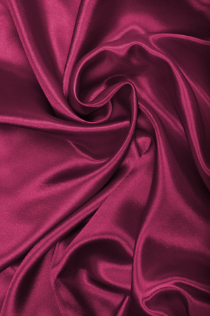 Smooth elegant burgundy silk or satin can use as background Stock Photo