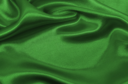 Smooth elegant green silk or satin luxury cloth texture can use as abstract background. Luxurious background design Stock Photo