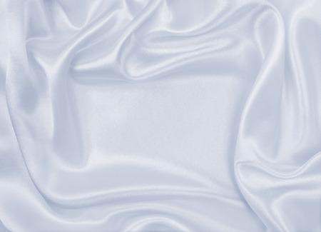 winter fashion: Smooth elegant grey silk or satin luxury cloth can use as wedding background. Luxurious background design