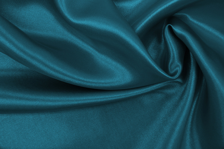 Smooth elegant blue silk or satin luxury cloth texture can use as abstract background. Luxurious Christmas background or New Year background design