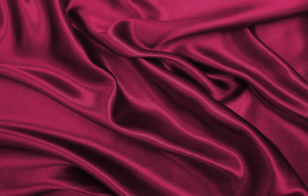 Smooth elegant pink silk or satin luxury cloth texture can use as abstract background. Luxurious valentines day background design