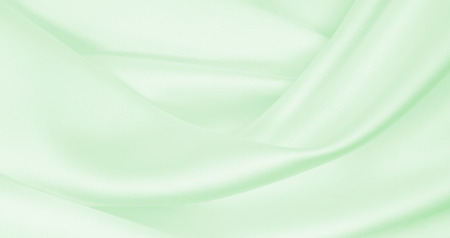 Smooth elegant green silk or satin luxury cloth texture can use as abstract background. Luxurious background design Reklamní fotografie - 92844547