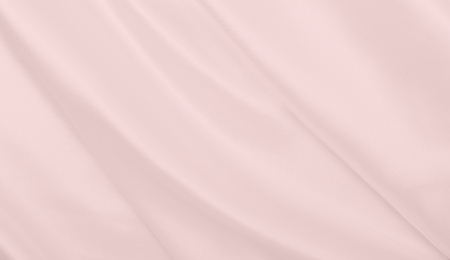 Smooth elegant pink silk or satin texture can use as wedding background. Luxurious valentine day background design