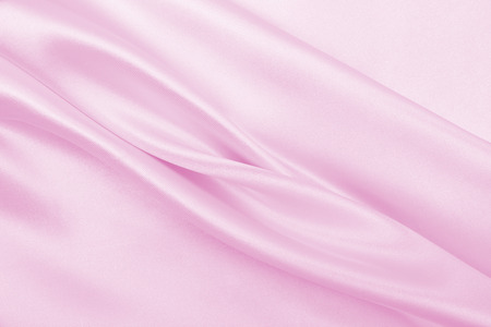 Smooth elegant pink silk or satin texture can use as wedding background. Stock Photo