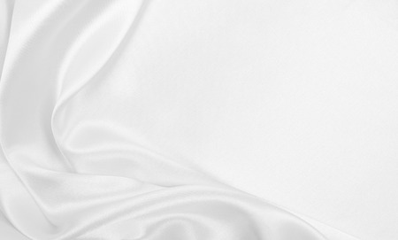Smooth elegant white silk or satin luxury cloth texture can use as wedding background. Luxurious Christmas background or New Year background design