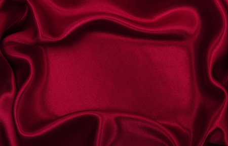 Smooth elegant red silk or satin luxury cloth texture can use as abstract background. Luxurious background design Stock Photo