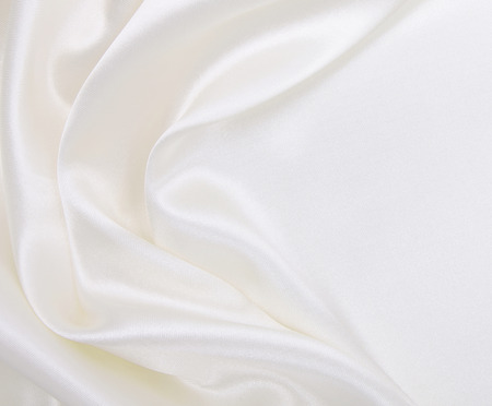 Smooth elegant white silk or satin luxury cloth texture can use as wedding background. Luxurious background design