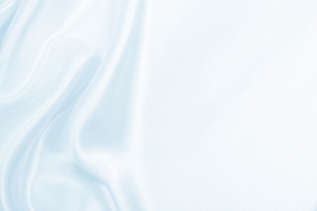 Smooth elegant blue silk or satin luxury cloth texture can use as abstract background. Luxurious background design