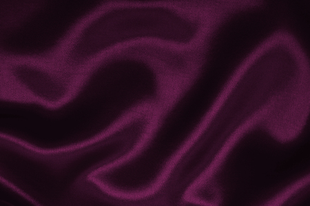 Smooth elegant pink silk or satin luxury cloth texture can use as abstract background. Luxurious background design