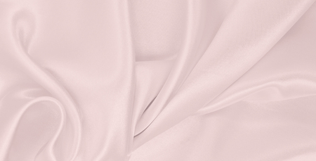 Smooth elegant pink silk or satin texture can use as wedding background. Luxurious background design