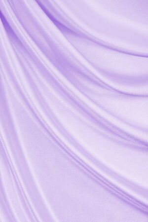 Smooth elegant lilac silk or satin texture can use as wedding background. Luxurious background design