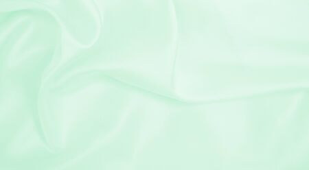 Smooth elegant green silk or satin luxury cloth texture can use as abstract background. Luxurious background design Reklamní fotografie