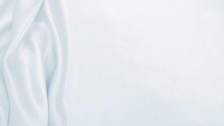 Smooth elegant grey silk or satin luxury cloth can use as wedding background. Luxurious background design