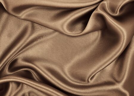 Smooth elegant brown silk or satin texture can use as abstract background. Luxurious background design. In Sepia toned. Retro style Imagens