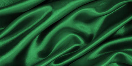 Smooth elegant green silk or satin luxury cloth texture can use as abstract background. Luxurious background design 免版税图像