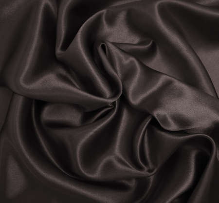 Smooth elegant brown silk or satin texture can use as abstract background. Luxurious background design. In Sepia toned. Retro style Foto de archivo
