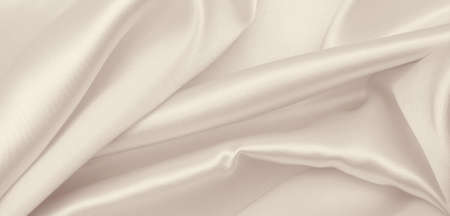 Smooth elegant golden silk or satin luxury cloth texture can use as wedding background. Luxurious background design. In Sepia toned. Retro style