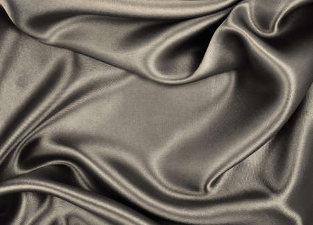Smooth elegant brown silk or satin texture can use as abstract background. Luxurious background design. In Sepia toned. Retro style