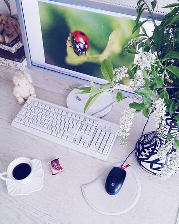 Workplace with coffee and flowers