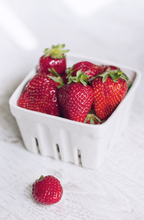 Fresh ripe strawberries on a white basket photo