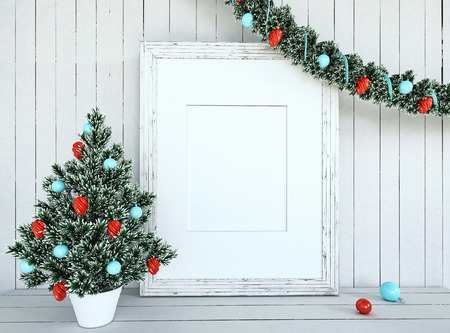 christmas card: Christmas Tree Decorationon with empty frame on white wood background