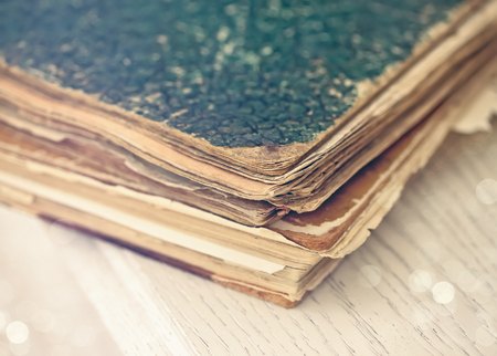 decrepitude: Old books of the Old binder on a wooden surface Stock Photo