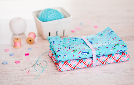 weave ball: Fabric Pile of colorful folded textile on white table Stock Photo