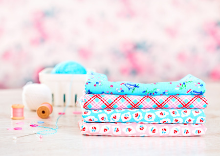 soft sell: Fabric Pile of colorful folded textile on white table Stock Photo