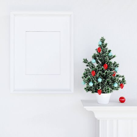 wall decor: Christmas Tree Decoration with empty frame on white wood background