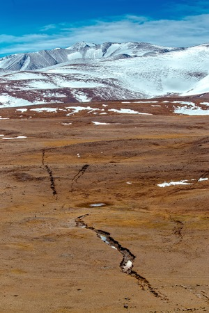 earthquake crack: Snowy mountains. crack after an earthquake. Severe mountains peaks covered by snow. Russia, Siberia, Altai mountains, Chuya ridge. Stock Photo