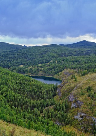ulagan: lake in the vicinity of the forest mountains pass Ulaganskiy. Altai, Russia