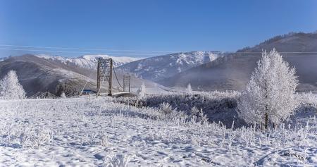 katun: Snowy bridge on foggy winter frosty morning, Russia, Siberia, Altai Stock Photo