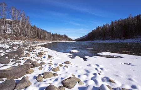Winter landscape by a river, Russia, Siberia Altai