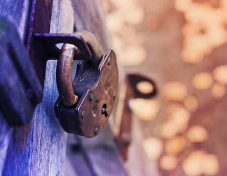 Lock on wooden Fence for Security with blur backdrop Stock Photo